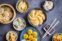 Dim sum assorted. Assorted dim sum appetizers on rustic background. Set of Chinese food for share. Asian buffet. Traditional Chinese dim sum food. Top view stock photos