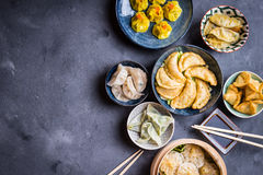 Dim sum background. Assorted dim sum appetizers on rustic background. Space for text. Chinese food for share. Buffet. Space for text. Traditional Chinese dim sum stock photography