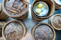 Dim sum bamboo basket containers in a restaurant Chinese food.  Royalty Free Stock Images