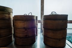 Dim sum bamboo basket containers in a restaurant Chinese food.  Stock Images