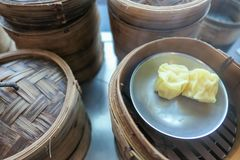 Dim sum bamboo basket containers in a restaurant Chinese food.  Royalty Free Stock Image