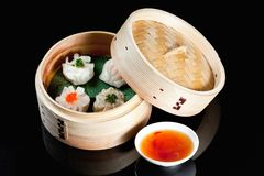 Dim sum  in bamboo basket  with red souce Stock Photos