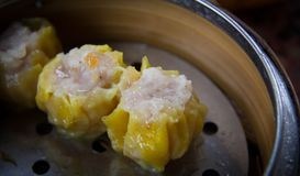 Dim sum in bamboo steamer. Chinese cuisine Royalty Free Stock Images