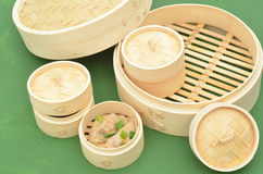 Dim sum bamboo steamer with Chinese dumplings Stock Photos