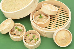 Dim sum bamboo steamer with Chinese dumplings Royalty Free Stock Image