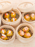 Dim Sum in Bamboo Trays. On wooden background Royalty Free Stock Image
