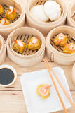 Dim Sum in Bamboo Trays. On wooden background Stock Images