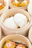 Dim Sum in Bamboo Trays. On Wooden Background Royalty Free Stock Images