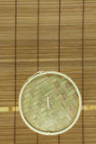 Dim-sum basket on mat. Dim-sum basket on bamboo background Royalty Free Stock Photo