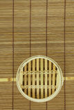 Dim-sum basket on mat. Dim-sum basket on bamboo background Stock Images