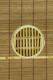 Dim-sum basket on mat. Dim-sum basket on bamboo background Stock Photos