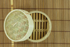Dim-sum basket on mat. White background Stock Photography