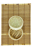 Dim-sum basket on mat. White background Royalty Free Stock Photos