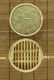 Dim-sum basket on mat. White background Royalty Free Stock Image