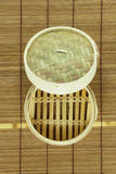 Dim-sum basket on mat. White background Stock Image