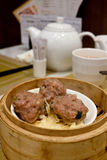 Dim sum. Beef ball ,together with hot chinese tea Stock Photos