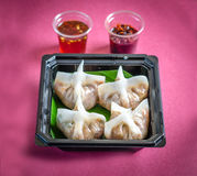 Dim sum with chilly sauce on a pink background Stock Photography