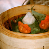 Dim sum cooked in steamer baskets. Stock Photo