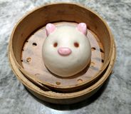 Dim Sum Custard bun. With cute pink pig character stock images