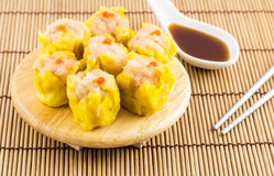 Dim Sum. Delicious chinese dim sum on wooden plate royalty free stock image