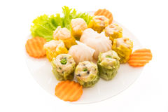 Dim sum. And dumpling - chinese food style in white plate isolated on white background Stock Photo
