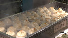 Dim sum dumplings food at Yuyuan Tourist Mart in Shanghai, China stock footage
