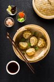 Dim sum dumplings in steamer and ingredients Royalty Free Stock Images