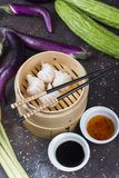 Dim sum dumplings in steamer with traditional chinese vegetables royalty free stock photography