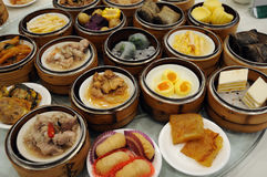 Dim Sum in Guangzhou. In the morning,Cantonese are used to chat with the family members and friends in the restaurant while having a cup of tea and Dim Sum stock image
