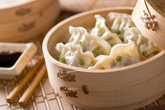 Dim Sum. With leeks, meat, and green onions in a bamboo steamer Royalty Free Stock Images