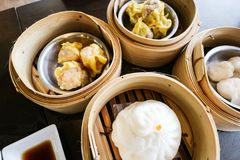 Dim sum put in the bamboo streaming with put on the wood table in chinese resturant Royalty Free Stock Image