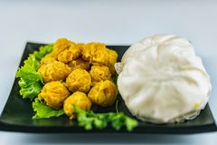 Dim sum - Steamed dumplings and steamed Chinese buns.  royalty free stock photo