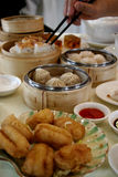 Dim Sum Table. Several bamboo steamers and plates of dim sum (Chinese tea snacks) in a restaurant Stock Photo