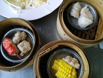 Dim sum in Thai restaurant. Dim Sum in Thailand, Chinese cuisine prepared as small bite-sized portions of food served in small steamer baskets.  Dim Sum in small stock photos
