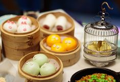Dim sum, traditional Chinese dumpling in bamboo steamer, pig and animal theme for kids. Street food for children in China, Hong royalty free stock images