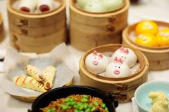 Dim sum, traditional Chinese dumpling in bamboo steamer, pig and animal theme for kids. Street food for children in China, Hong. Kong. Family dinner with royalty free stock image