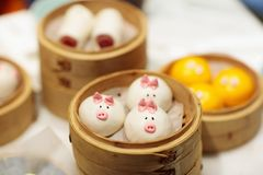 Dim sum, traditional Chinese dumpling in bamboo steamer, pig and animal theme for kids. Street food for children in China, Hong. Kong. Family dinner with stock image