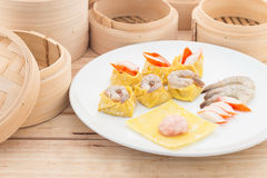 Dim Sum in white plate. Dim Sum in white plate on wooden background Stock Photo