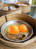 Dim sum, York egg on pork Dumpling in the basket Stock Photo