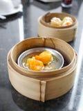 Dim sum, York egg on pork Dumpling in the basket Royalty Free Stock Photos