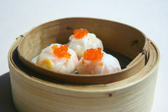 Dim Sums. Dim Sum in Bamboo Baskets with fish eggs Royalty Free Stock Photography