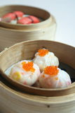 Dim Sums. 3 kind of Dim Sum in Bamboo Baskets Stock Image