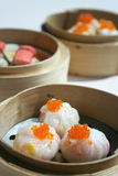 Dim Sums. 3 kind of Dim Sum in Bamboo Baskets Royalty Free Stock Images