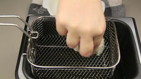 Dim Sums Into Fryer. Putting dim sums into the basket and dropping into a deep fryer with hot oil stock video footage