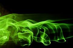Dimensión de una variable abstracta del fondo - humo verde Fotos de archivo
