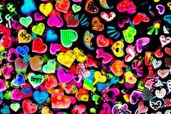 Dimensión de una variable colorida del corazón aislada en fondo negro stock de ilustración