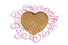 Dimensión de una variable de los corazones cortada de carboard Imagen de archivo