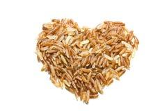 Dimensión de una variable del corazón del arroz moreno Fotos de archivo
