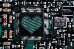 Dimensión de una variable del corazón en tarjeta de circuitos Fotografía de archivo libre de regalías