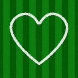 Dimensión de una variable del corazón en un campo de fútbol Imagen de archivo libre de regalías